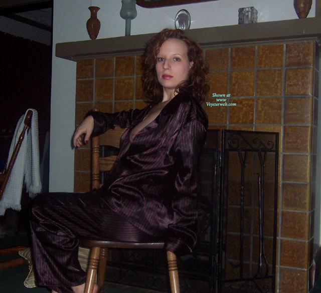Pajama Party - Black Hair, Long Hair, Red Hair , Striped Satin Pj's, Long Curly Auburn Hair, Black And Red Silk Pajamas, Nipple Peeking Pajamas, Boob Slip, Sitting On Chair, Long Sleeved Pyjamas, Purple Striped Satin Pajamas, Men's Silk Pj's, Exposing One Breast, Side Blouse