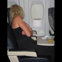 Naughty Blond With Curls Exposing Tits On An Airplane - Blonde Hair , Sitting On An Airplane, Seated On Airplane, Boob Flash On Airplane, Arms Crossed, Exposed Breast, Mile High Boob, Single Breast Out, Exposed On Airplane