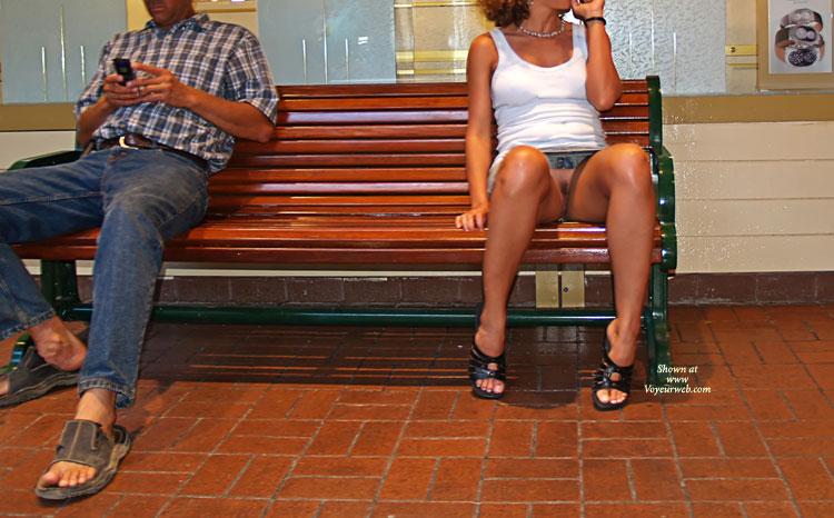 Upskirt On Bench - Brunette Hair, Upskirt , Open Toes Shoes, Skirt Flash, No Panty, Denim Skirt, Public Nudity, White Tanktop, Tanned Brunette, Sitting On A Bench, Public Upskirt