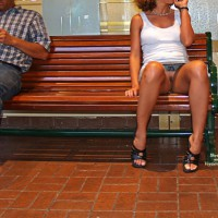 Upskirt On Bench - Brunette Hair, Upskirt , Open Toes Shoes, Skirt Flash, No Panty, Denim Skirt, Public Nudity, White Tanktop, Tanned Brunette, Sitting On A Bench, Public Upskirt