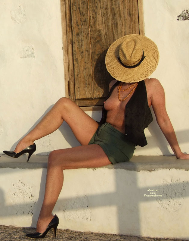Exposing Her Tits Through Open Vest - Naked Girl, Nude Amateur , Green Shorts, Sitting Sideways, Sitting On A Ledge, Classic Nude, Black Vest, Very High Heeled Black Pumps, Nice Firm Breast, Straw Hat, Medium Natural Breasts, Shapely Firm Legs