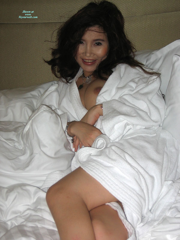 Asian Girlfriend In Bed - Black Hair, Looking At The Camera , Nipple Poking Out Of White Robe, Lots Of Black Hair, One Breast Showing, Sexy Asian, Oriental Goddess, Smiling And Looking At The Camera, Nipple Slip, White Terry Robe, Girl In A Nice White Robe Showing A Little Tit, Asian Eyes, Silver Necklace