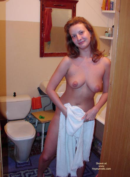 Topless In The Bathroom , Topless In The Bathroom, Redhead Standing In Bathroom, Pussy Covered By Towel, Posing In Bathroom, Looking At Camera