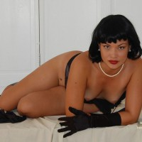 Sultry Reclined Pose On Bed - Black Hair, Perky Tits, Red Hair, Small Breasts, Small Tits, Looking At The Camera , Tanned Body, Pearl Earrings, Shapely Body, Black Skirt Pulled To The Waist, Pearl Necklace, Glamorous On White, Small Perky Tits, Red Lipstick, Black Elbow Length Gloves, Artistic On White