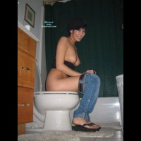 Girl On The Toilet - Perky Tits, Topless , Black Tube Top, Topless Toilet Tease, Flip-flops, Naked Breast, Black Flip Flops, Potty Shot, Smile For The Camera, Blue Jeans With Black Belt