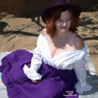 Buxomgirl38e in a purple corset!