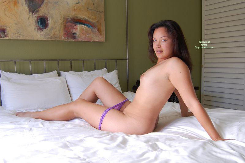 Naked On Bed - Brown Hair, Long Hair, Small Tits , Leaning Slightly With Arms Supporting Body, Sitting On Bed, Looking Over Shoulder, Purple Panties Around Thighs, Out Of Her Purple Thong, Model In Profile With Head Turned To Camera, Three-quarter View, Asian Beauty, Semi Reclining, Perky Nipples, Small Boobs, Panties On The Way Down, Side View, Seated, Leaning Back On Hands, Legs Jutting Forward, Panties Pulled Down To Thighs