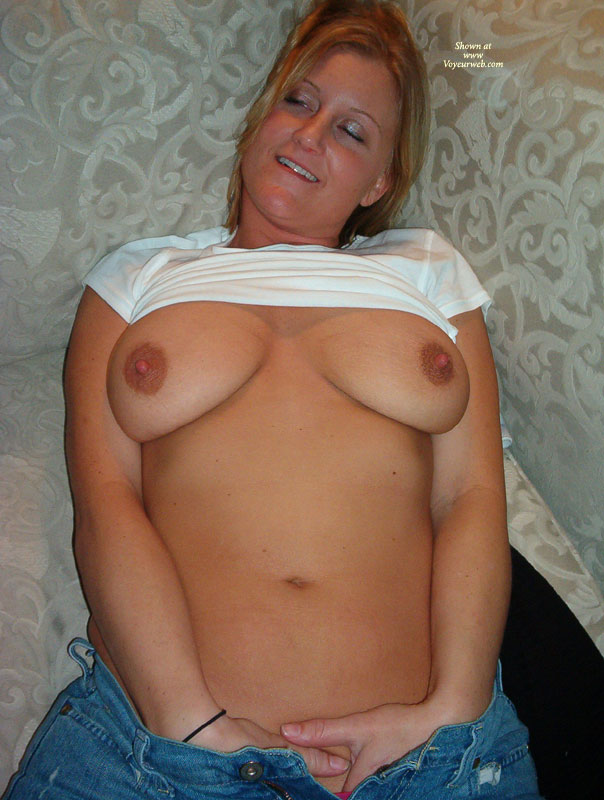 Enjoying Herself - Big Tits, Erect Nipples , White T-shirt, Lifted White T-shirt, Blue Jeans, Kicking Back, Feeling Good, Indoor Tit Shot, Both Hands Down Pants