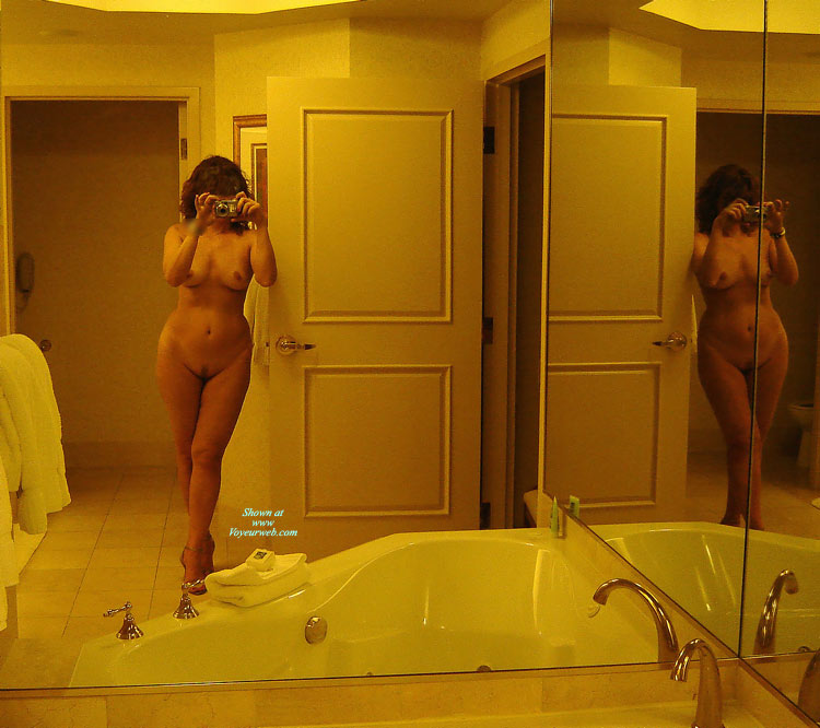 Beauty With Curves Takes Her Own Nude Self Portrait In The Mirror - Heels, Landing Strip, Milf, Self Shot, Naked Girl, Nude Amateur, Sexy Legs , Full Frontal Nudity, Double Frontal Nude, Hands Holding Camera In Front Of Face, Camera Before Face, Self Picture In Mirror, Mirror Image, Hourglass Figure, Standing Leaning On A Door, Standing In Bathroom