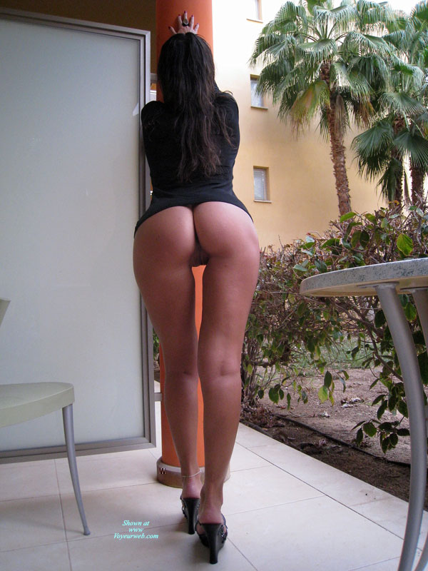 Standing On A Porch - Black Hair, Heels, Long Hair, Round Ass , Bottomlesss, Ass Toward Camera, Palms Against The Wall, Rearview, Silver Anklet, One Leg In Front Of The Other, Rearview Pussy