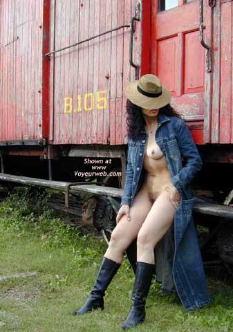 Long Denim Coat , Long Denim Coat, Black Leather Boots, Beside A Train