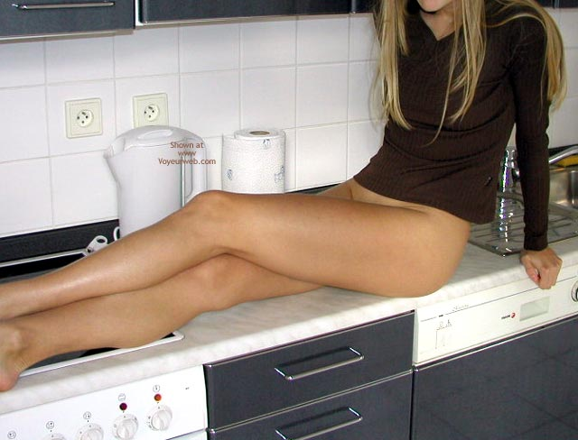Girl Sitting On The Counter - Legs Crossed, Long Legs , Girl Sitting On The Counter, Long Legs, Kitchen Counter, Legs Crossed