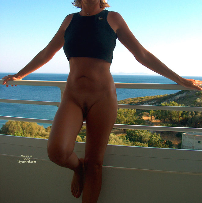 Tina : On The Terrace , While On Holidays Last Year In Greece, Tina Was Ready After The Shower To Cool Off In The Terrace With Just A Small Top.... Enjoy !<br /><br />Tino