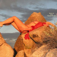 Girl Outdoors On Rocks - Artistic Nude , Girl Outdoors On Rocks, Red Feathers, Artistic Nude, Clear Strap Heels
