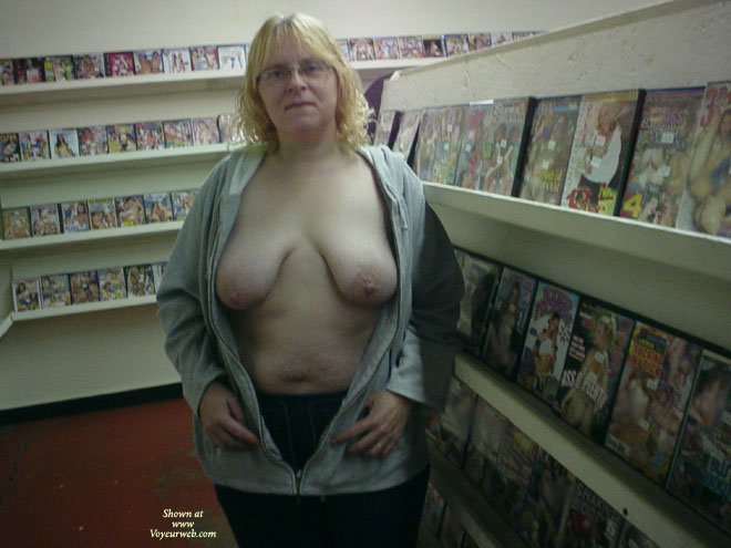 Florida Mom Flashing In Adult Video Store , Florida Mom Started Out Flashing Guys In The Store Then Ended Up In The Video Booths In The Back Room Where One Of The Guys Came Up & Played With Her Tits. He Even Sucked On Her Nipples While I Watched Then I Joined Him. It Was The First Time She Had 2 Guys Sucking On Her Big Nipples At The Same Time. She Was Nervous So We Left Quickly But When We Got To The Car She Said She Was Very Wet & Horny After Having Both Of Her Tits Sucked On