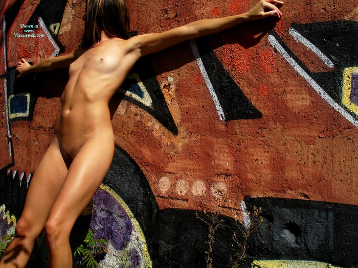 Standing Up Arms Straight Out - Small Breasts, Small Tits , Looking Away, Head Turned Away From Camera, Arched Back, Skinny Body, Posed Against Grafitti, Against The Wall, Lean Against Wall