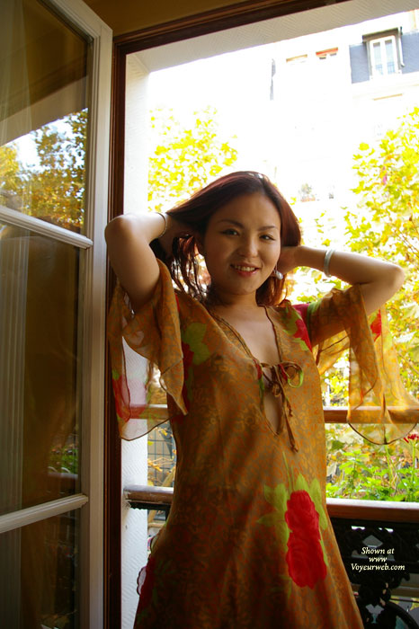 Chinese Ash , Cute 25 Years Old Adventurous Chinese Girl Who Came A Long Way To Europe To Have Her Picture Taken.