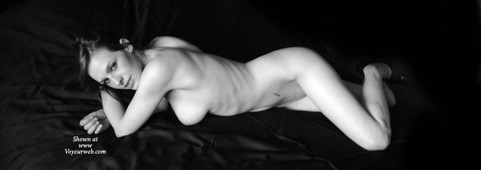 Nude Wife Sexy Black And White Pose - Long Legs, Looking At The Camera, Naked Girl, Nude Amateur, Nude Wife , Artistic On Black, Arms Crossed, Sexy Smile, Lying Down, On Bed, Lying On Black Satin Sheets, Classic Black And White, Long Lean Legs
