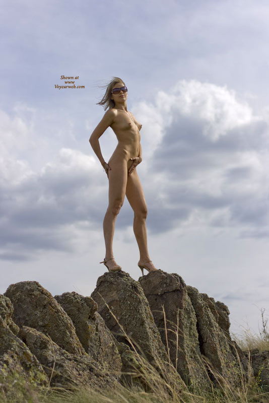 Naked Girlfriend On High Heels Staning On A Rock - Blonde Hair, Heels, Long Hair, Sunglasses , Wind Blown Hair, Standing On Rocks, Shoulder-long Straigth Blond Hair, Landscape Lady, Clouds In Background, Flat Belly, Fit Body, Sun Glasses, Skinny Body, Heels And Sunglasses, A Little Risky For High Heels, Standing On Rocks Wearing High Heels