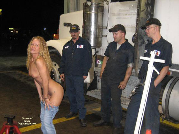 Mooning Truck Drivers - Topless , Blue Denim Jeans, Showing Her Bum To An Audience, Jeans Half On, Smiling Topless Beauty, Leaning Forward With Jeans Down To Her Knees