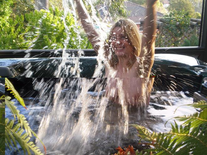 Blond Topless Splashing - Blue Eyes, Topless , Water Nymph, Water Splash, Indoor Hot Tub, Arms Raised, Playing In Water, Hot Tub Fun, Blond Water Fun, Splashing In Spa