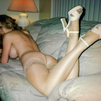 Lying On A Sofa - Big Tits, Heels, Long Legs, Looking At The Camera , Looking Back Toward The Camera, Tan Lace Top Stockings, Tit And Ass Shot, Big Tits On Couch Face Down, Backshot, White Strap High Heels, In Her Living Room, Legs And Heels, Shapely Long Legs