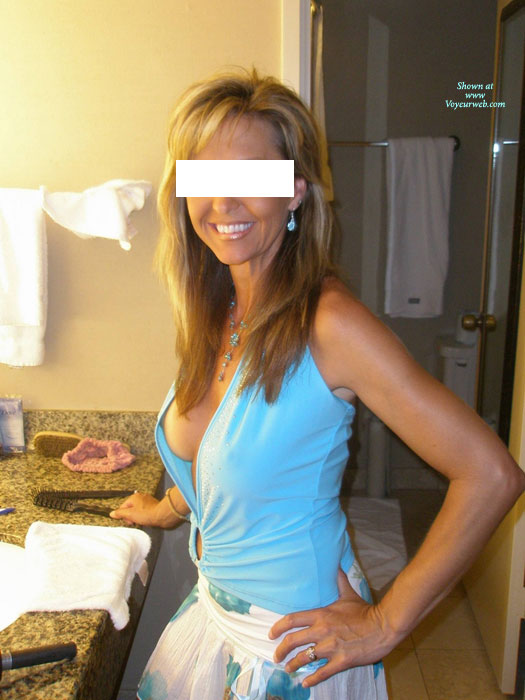 Sideblouse Shot - Blonde Hair, Long Hair, Milf , Peek A Boo, Dressed Girl Standing In Bathroom, Sexy Blue Top, Boob Slip, Fit Milf, Side Cleavage Of Athletic Woman, Beautiful Smile.