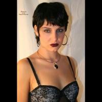 Sexy Face - Black Hair, Sexy Face , Short Straight Black Hair, Hazel Eyes, Hooped Ear Rings, And Necklace, Green Eyes, Evening Make Up, Dark Lip Stick, Full Lips, Caucasian, Grey Silk Basque