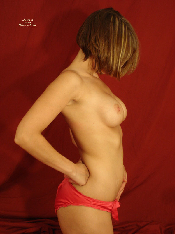 Topless Wife Profile Shot - Topless, Naked Girl, Nude Amateur, Topless Wife , Chin Length Hair With Side View Of Breasts, Panties But No Top, Short Cropped Hair, Semi Nude In Red Panties, Right Profile, Fit Athletic Build, Hand On Hip, Red Satin Panties, Red Panties, Profile View Standing