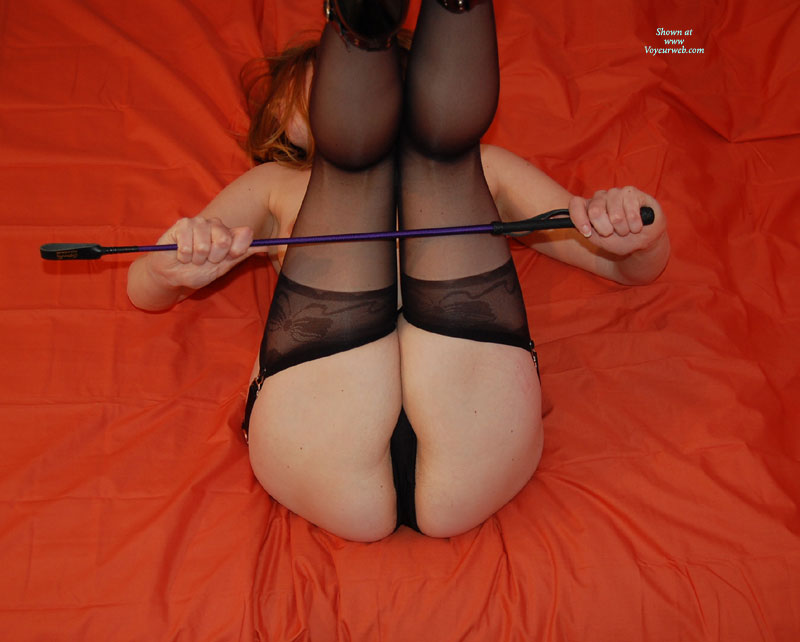 Girl In Bed Riding Crop In Hands , Laying On Back - With A Riding Crop, Thigh High Black Garters, Black Garter, Holding A Riding Crop, Stockings, Stockings And Crop, Thigh High Stockings, Face Hidden, Waiting For Punishment, Black Thigh Highs, Spank This, Black Lingerie