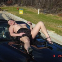 Hood Ornament - Heels, Small Tits, Topless , Topless Leisure, Reclining On Car Hood, Posing Outdoors On The Car, Black Strappy High Heels, Black Dress, Lying On A Car, One Knee Up One Knee Down, Posing With Car Outdoors