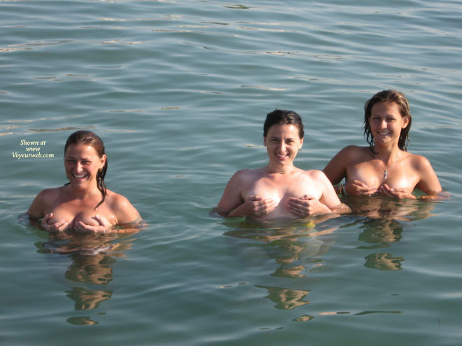 Three Ladies Up To Their Tits In Water And Hand Cups , Covering Breasts With Hands, Holding Breasts, Pinching Nipples, Hands Covering Breasts, Tits In Water, Standing In Water, 3 Pairs Of Boobs Floating, Six Hands Full Of Boobs, Hand Bras Times 3, Smiling Cuties In The Sea, Holding Breasts