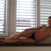 Topless By The Window - Brown Hair, Long Hair, Long Legs, Small Breasts, Small Tits, Topless, Small Areolas , Black Necklace, Black Strappy Heels, Lean Body, Black Ankle Wrap Sandals, Little Tits, Black Panties