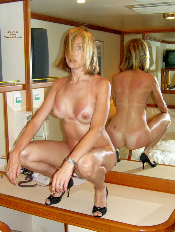 Naked On Cruise Ship - Black Hair, Blonde Hair, Heels, Milf, Tan Lines, Naked Girl, Nude Amateur , 3/4 Frontal Kneeling Nude In High Heels, Tattoo On Right Lower Back, Black Pumps, Reflection In Mirror, Black Heels, Front And Back Mirror Shot, Black Stiletto Heels