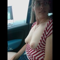 Riding In Car With Her Breasts Exposed - Flashing, Large Aerolas, Pale Skin , Pale Skin, Other Vehicle In Background, Red And White Striped Blouse, Naked Librarian, Small Hanging Boobs, Looking Away From Camera, Car Flashing, Wearing Glasses