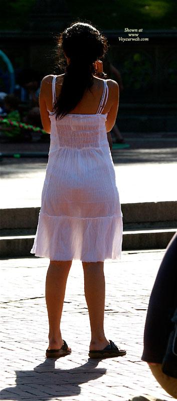Voyeur Shot Of A Girl In See-through Dress - Brunette Hair, Long Hair, See Through , Long Brunette Hair, White Panties, White Linen Dress, White See Through Dress, Street Voyeur, See Through Ethnic Dress White Thong, White Bra, Caramel Skin, Brown Sandles