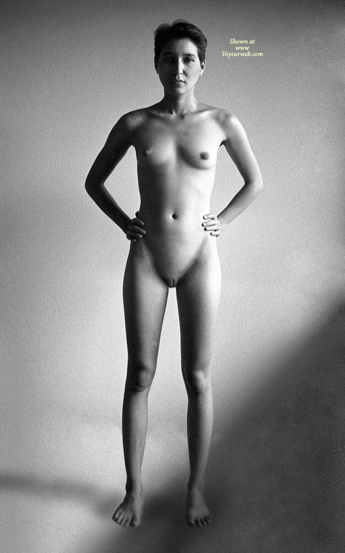 Nude Art - Shaved Pussy, Small Breasts, Naked Girl, Nude Amateur , Shaved Muff, Black And White Photo, Black And White Nude, Standing Full Frontal, Skinny Body, Teen Tits, Boyish Hair Cut