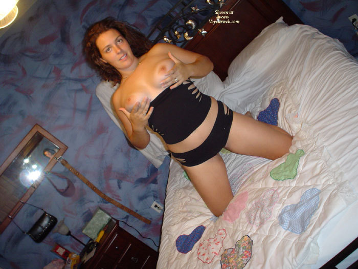 Teasing Girlfriend On Bed - Black Hair, Dark Hair, Topless Girl, Topless , Ring On Each Hand, Showing Tits, Indoor Tits, Blue Socks, Torn Top And Pants, Topless On Bed, Dark Auburn Hair, Confused Look, Black Top And Pants