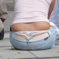 Thong Peeking Out Of Jeans , White Thong, Thong Above Jeans, Denim Blue Jeans, Thong Peeking Out, Pink T-shirt, White G-string, Faded Denims Revealing Thong, Pull Me, Panty Watching