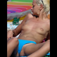 BLOND TOPLESS AT THE BEACH - Blonde Hair, Navel Piercing, Shaved Pussy, Topless, Beach Voyeur , Puffy Areolas, Tiny Nipples, Pussy Lip Peaking Out, Left Labia Slightly Exposed, Bleached Blonde Hair, Body Piercing