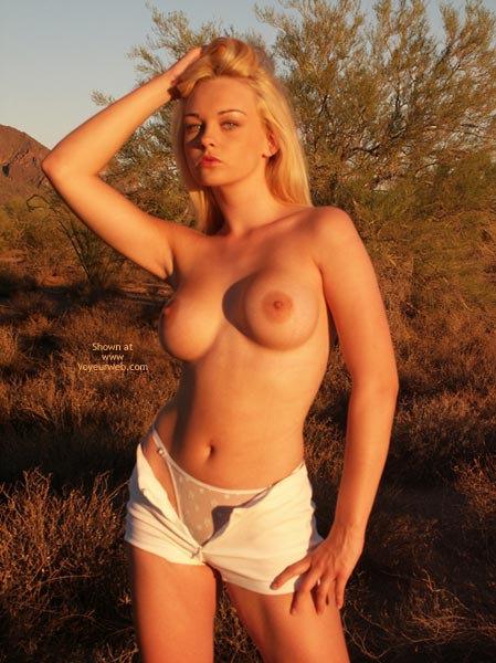 Topless With Open Shorts And Panties - Nude Amateur , Topless With Open Shorts And Panties, Blonde At Sunset, Outdoors Posing, Large Firm Breasts, White G-string Panties, Short Shorts, Sunset Nude