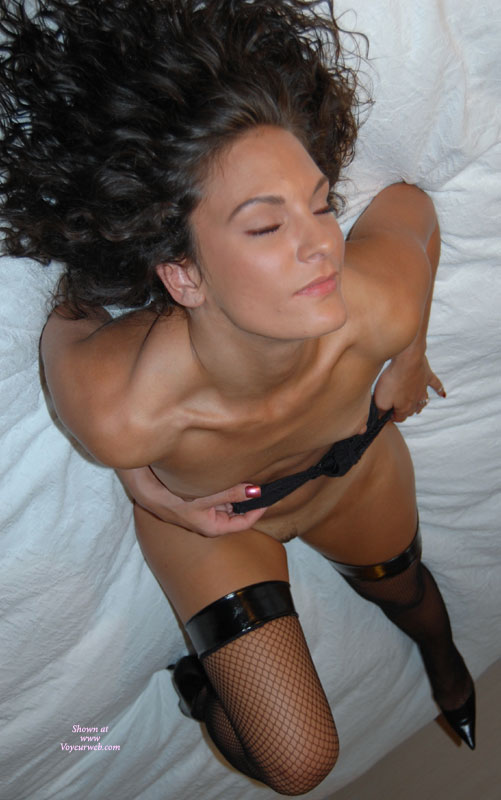 Black Vinyl Topped Fishnet Stockings - Black Hair, Brown Hair, Brunette Hair, Heels, Stockings , Curly Brunette, Pulling Bra Down, Shoulder Length Brown Hair, Girl Lying On Her Bed, Small Boobs, Black Fishnet Stockings, Curly Black Hair, Black Heels And Fishnets, Black Bra Pulled Down, Closed Eyes
