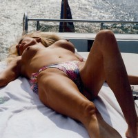 Topless Wife On The Boat - Blonde Hair, Long Hair, Milf, Topless, Topless Wife , Multicolor Ruffle Back Thong Bikini Bottom, Sexy Milf Body, On The Boat, Lying Lady, Girl & Boat, Large Erect Nipples