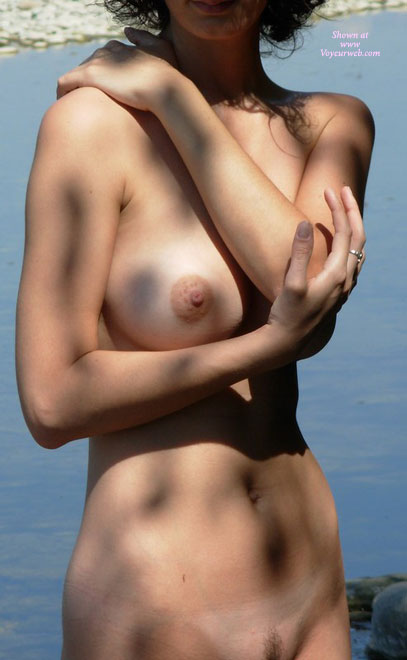 Nude Girl Hand On Shoulder - Big Tits, Trimmed Pussy, Naked Girl, Nude Amateur , Large Round Breast, Perfect Nipple, Standing Frontal View, Water In Background, Tits Outdoors, Nude Outdoors, Nude Girl In The Shade, Nice Airstrip Trim