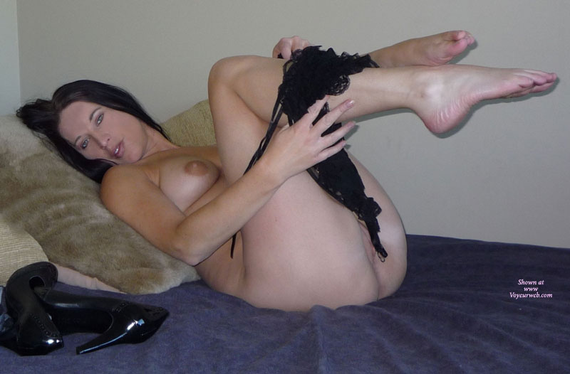 Naked Brunette On Bed Removing Black Teddy - Blue Eyes, Brunette Hair , Knees Up In The Air, Lying On A Bed Naked, Removing Black Teddy, Legs In The Air Taking Off Teddy, Taking Off Panties, Legs And Feet, Black Heels Lying On Bed, Beautiful Blue Eyes, Pussy And Breasts Showing