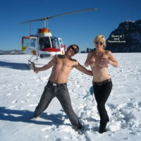 Topless Man And Woman With Helicopter - Blonde Hair, Sunglasses, Topless , Standing Topless In Snow With Helicopter In Backgound, Topless Only, Hot In Cold Snow, Topless Blonde With Chopper, Couple With Helicopter, Sun Glasses, Black Jeans, Covering Tits In The Snow, Topless In The Snow
