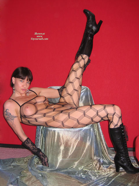 Fishnet Bodystocking - Black Hair, Brunette Hair, Sexy Face , Knee High Black Lace Up Boots, Black Boots, See-thru Bodysuit, Earrings, Dressed In Net, Naked In Nets, Brunette Short Hair, Black Lace Gloves, Sexy Demanding Face, Black Boots, Black Body Stocking