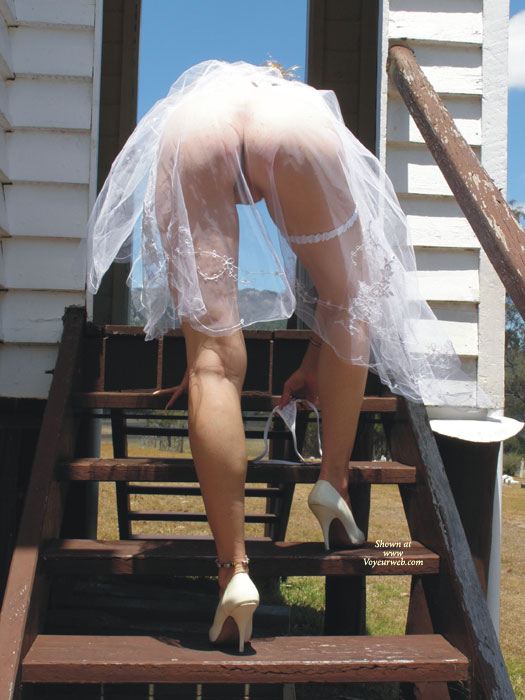 Going Up Stairs No Underwear - Heels, Long Legs , White Heels And Garter, Ankle Bracelet, White See Thru Skirt, Pantyless Wedding Dress, White High Heels, White See Through, Long Legs And Heels, Garter And Ankle Braclet, White G-string, Bending Over