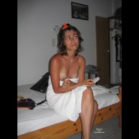 Sitting On Bed With Towel Boobs Exposed - Brunette Hair, Topless , Sitting On Bed Topless, Worried Brunette In Towel After Shower, Sitting On Bed Breasts Showing, Holding Condom, Amateur, Wrapped In Towell, Sitting On Bed
