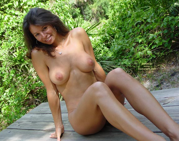 Long Slim Legs , Long Slim Legs, Nude Outside, Long Brown Hair, Nude Sitting On Picnic Table Outdoors, Large Areola, Looking At Camera